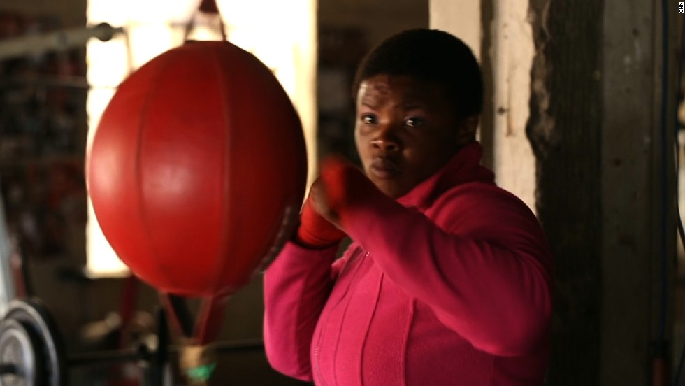 Rita Mrwebi, the South African female welterweight champion, trains inside Hillbrow Boxing Club as she prepares for a big title match next month.