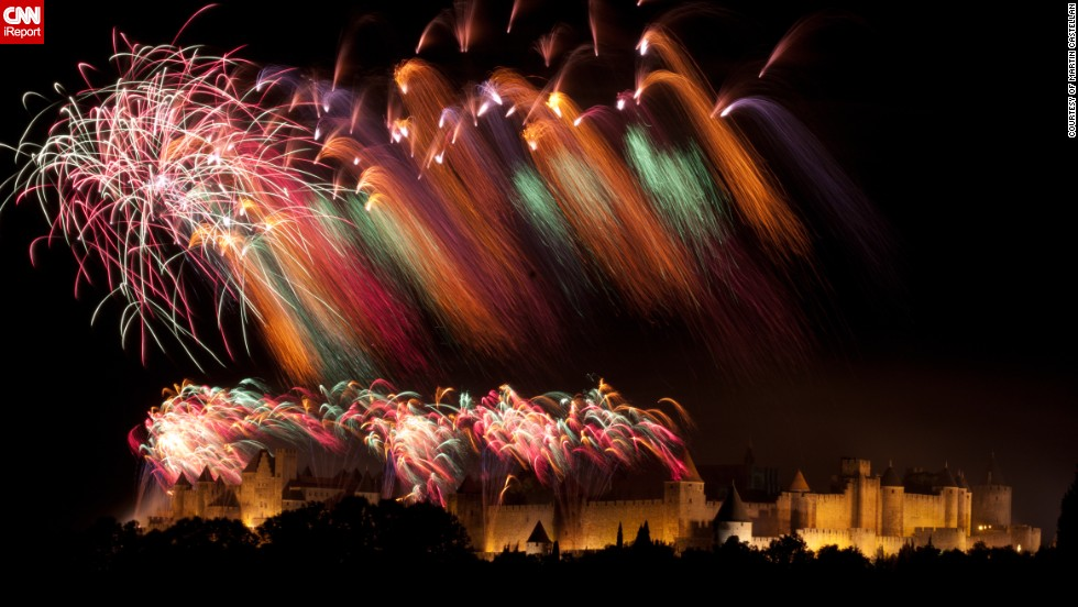 "Photographer Martin Castellan, 62, took this color cascading photo of the Bastille Day fireworks in the city of <a href=""http://ireport.cnn.com/docs/DOC-996276"" target=""_blank"">Carcassonne in the south of France</a>. Bastille Day is celebrated on July 14 and commemorates the storming of the Bastille prison in Paris in 1789 -- an event which triggered the French Revolution. <br /><br />Mr Castellan says the city's 11th century castle was built by the Cathars, a Christian sect seeking protection from the Pope's armies, and in 1991 it doubled for Nottingham in Kevin Costner's Robin Hood - Prince of Thieves film."