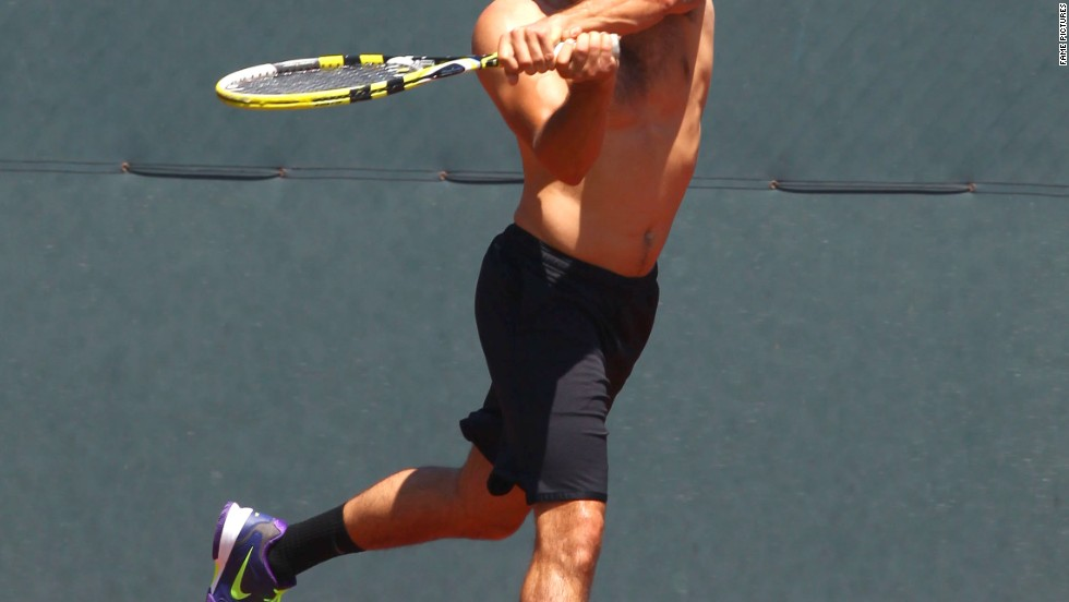 """Dallas"" actor Jesse Metcalfe gets in a game of tennis on July 10."
