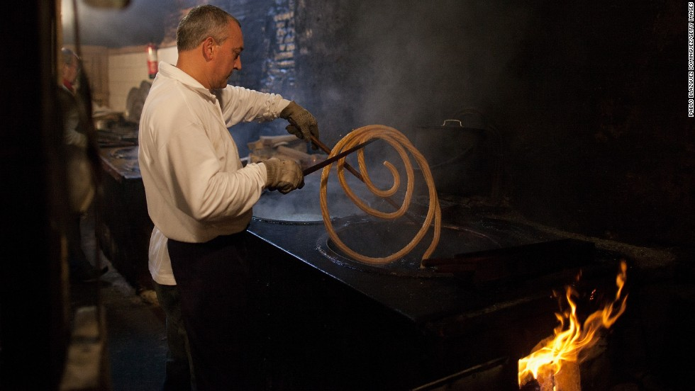 A man makes churros, often referred to as Spanish doughnuts, early July 11 in Pamplona.