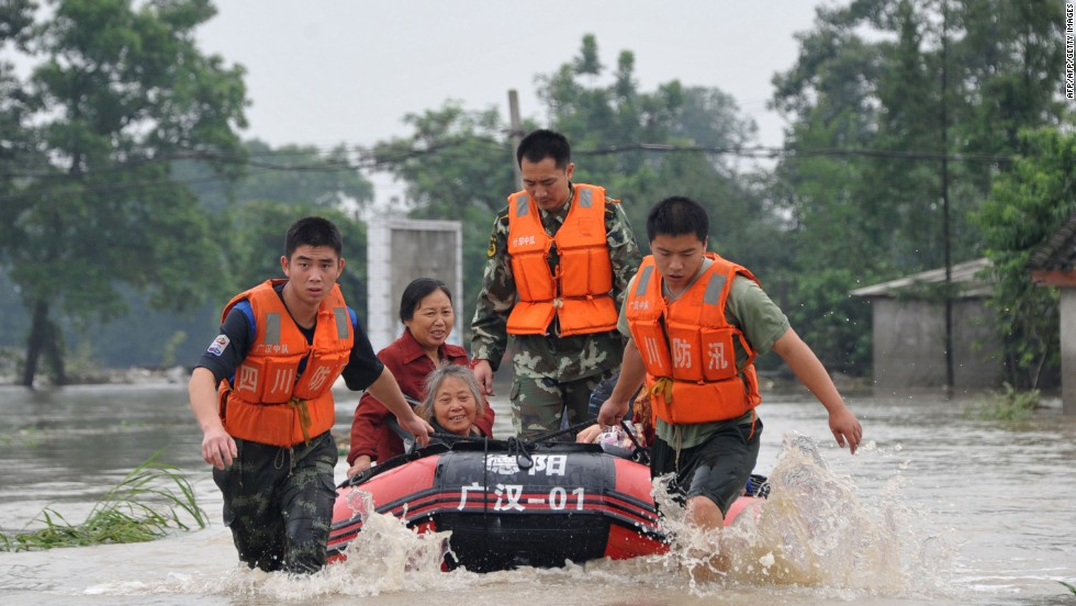 Rescuers use boats to relocate victims as the Tuo River floods Jintang county on July 11. The area is roughly 1,100 miles southwest of Beijing, the capital of China.