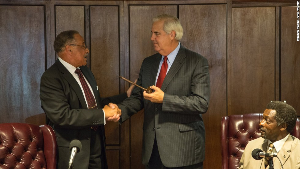 At his swearing-in ceremony in early July, Bill Luckett, right, takes the helm of the city from outgoing Mayor Henry Espy, who stepped down after serving for more than 20 years. Clarksdale's new mayor says he doesn't believe the speculation about why McMillian was killed.