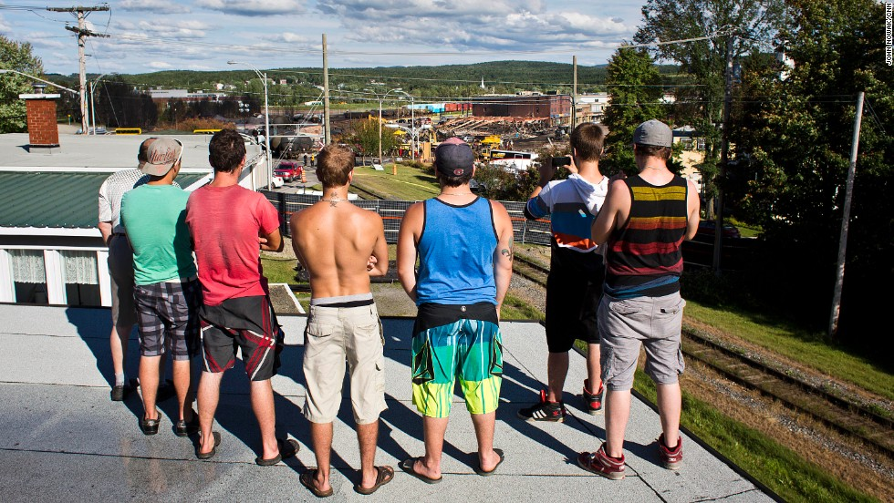 Shortly after authorities open some barricaded streets, a group of young men stop by to check out the wreckage in downtown Lac-Megantic. It is a sad and stunning sight.