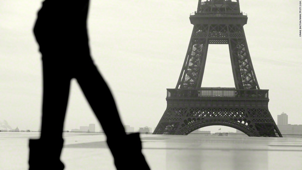 "Paris, France; Craig Easton, United Kingdom; winner, Cutty Sark Award and overall winner of the Travel Photographer of the Year 2012. French privacy laws dictated that that no one be recognizable in Easton's street images, leading him to the idea of anonymous silhouettes against a highly recognizable background. ""Striking graphic images"" was the judges' verdict, applauding his success in making an artistic victory out of such restrictions."
