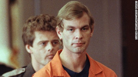 MILWAUKEE, WI - AUGUST 6:  Suspected serial killer Jeffrey L. Dahmer enters the courtroom of judge Jeffrey A. Wagner 06 August 1991. Dahmer has been charged with eight additional counts of first-degree murder, bringing the number of homicides he is charged with to 12. The judge increased Dahmer's bail to five million dollars. He was sentenced to fifteen consecutive life terms or a total of 957 years in prison. Dahmer was killed by a fellow prisoner, Christopher Scarver, 28 November 1994 at Columbia Correctional Institution, Portage, Wisconsin. (FILM)  (Photo credit should read EUGENE GARCIA/AFP/Getty Images)
