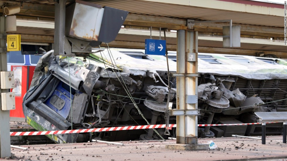 A train car lies on its side at Bretigny-sur-Orge station on July 12.