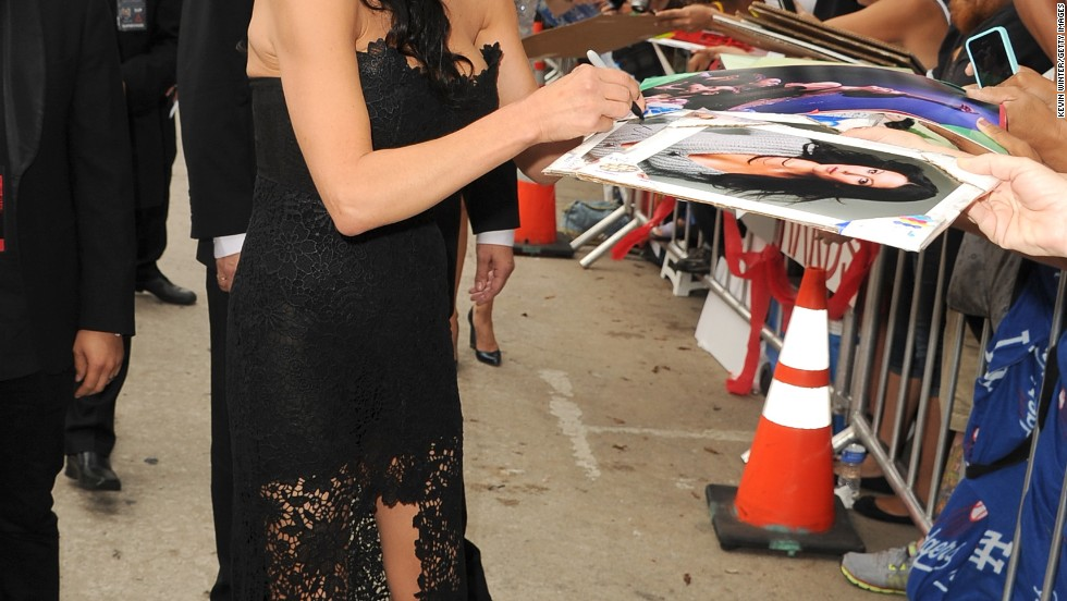 """Catherine Zeta Jones signs autographs at the """"Red 2"""" premiere in Los Angeles on July 11."""