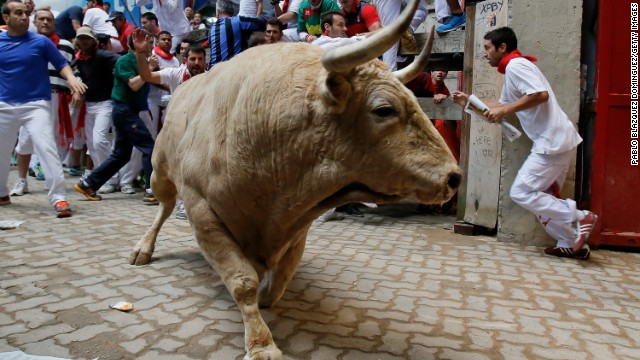 A fighting bull enters the bull ring during the eighth day of the San Fermin Running Of The Bulls festival on Saturday, July 13, in Pamplona, Spain.