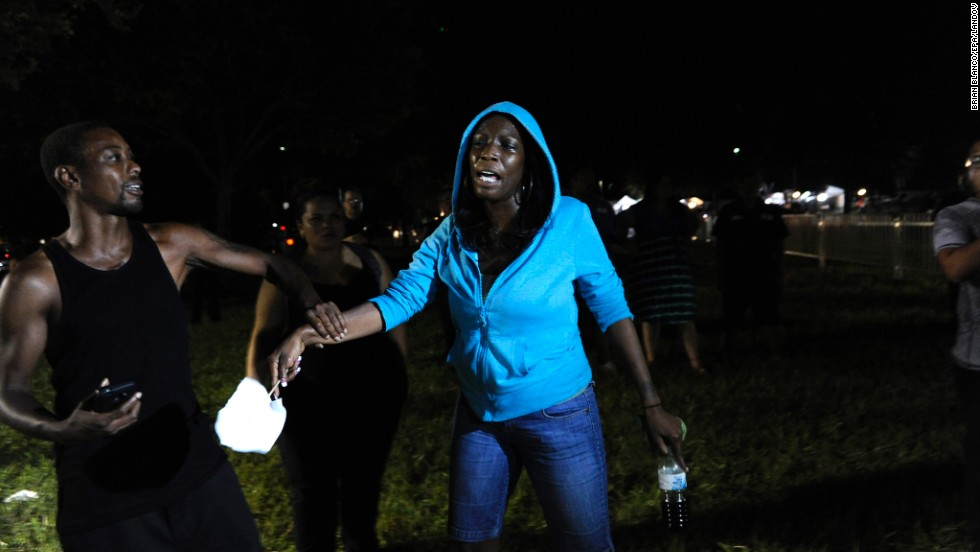 "A Trayvon Martin supporter rallies outside the courthouse on July 13. After Martin's death, <a href=""http://www.cnn.com/2012/03/27/living/history-hoodie-trayvon-martin/index.html"">protesters started wearing hoodies</a> in solidarity against racial profiling."