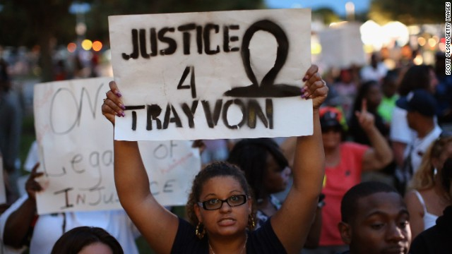 SANFORD, FL - JULY 13:  Supporters of Treyvon Martin wait in front of the Seminole County Criminal Justice Center for the verdict to be announced in the George Zimmerman murder trial on July 13, 2013 in Sanford, Florida. The jury found Zimmerman, a neighborhood watch volunteer, not guilty in the February 2012 shooting death of 17-year-old Treyvon Martin.  (Photo by Scott Olson/Getty Images)