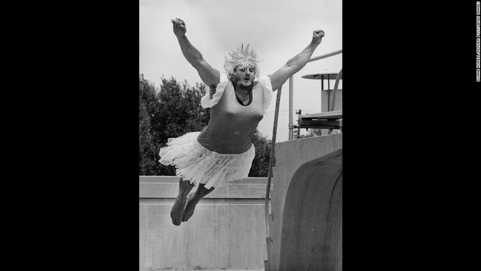 A man jumps into a pool during the World Belly-Flop & Cannonball Diving Championships in Colorado in 1981. The costume just adds a touch of flair.