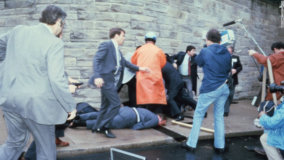 As people storm the scene of the crime, Reagan is rushed to George Washington University Hospital in a split-second decision that possibly saved his life. The bullet penetrated within an inch of the president's heart, filling one lung with blood.