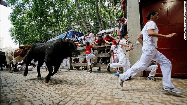 Thrill seekers race amid Miura's bulls during the last bull run of the San Fermin Festival in Pamplona, Spain, on Sunday.