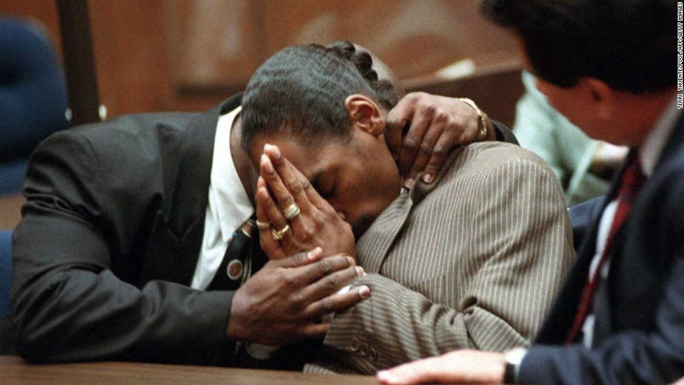 "Rapper <a href=""http://www.cnn.com/US/9602/snoop/"">Snoop Dogg</a>, whose real name is Calvin Broadus, is embraced by his former bodyguard McKinley Lee in 1996 after they were both acquitted of murder charges in the shooting death of an alleged gang member. Ironically, a music video released before the trial for the song ""Murder Was the Case"" features Snoop as a man who kills someone in self-defense and is then convicted of murder."