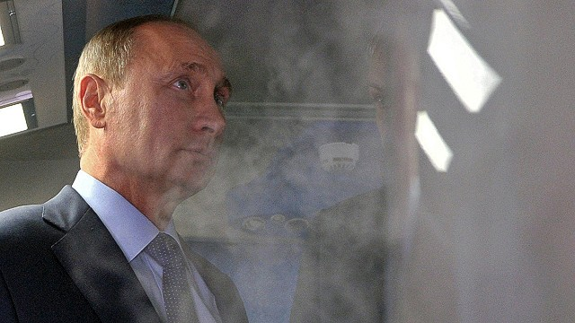 Russian President Vladimir Putin inspects the medical support mobile systems of the Russia Federal Medical and Biological Agency and the capabilities of cryogenic saunas operating at the Universiade 2013 on July 12, 2013. AFP PHOTO/RIA-NOVOSTI/POOL/ALEKSEI NIKOLSKYALEKSEI NIKOLSKY/AFP/Getty Images