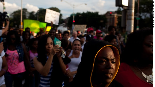 Activists rally in Chicago's South Side for Trayvon Martin as well as calling for an end to gun violence in their own city on July 15, in Chicago, Illinois.
