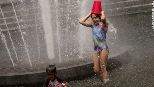 Young children cool off in a fountain in New York's Washington Square Park on Monday.