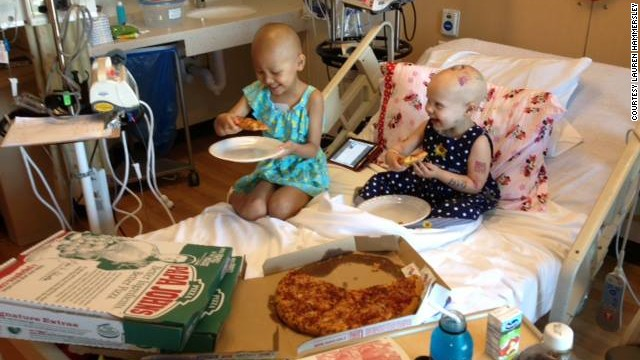 Cancer patient Hazel Hammersley, right, and a friend enjoy pizza at a Los Angeles hospital.
