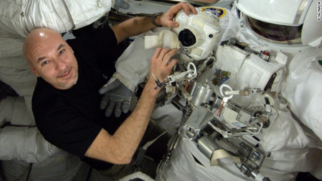 NASA aborts spacewalk due to water in suit