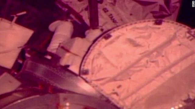 NASA aborts spacewalk, water in suit
