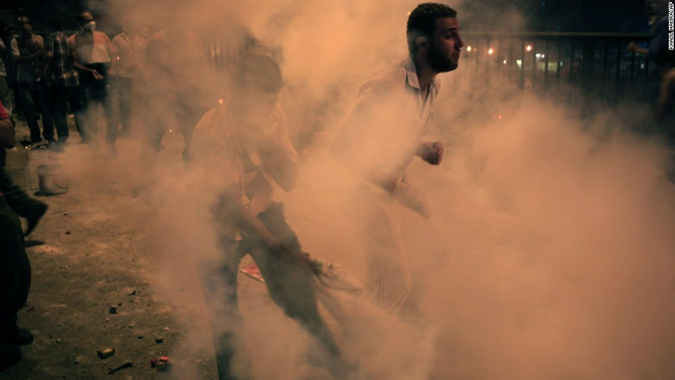 Morsy supporters run from tear gas in Cairo on July 15.
