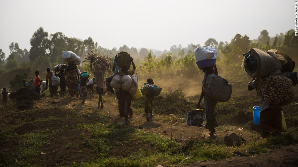 """JULY 16, GOMA, EASTERN DRC: Displaced Congolese flee Kanyarucinya for Munigi on the outskirts of Goma in the east of the Democratic Republic of Congo on July 15. <a href=""""http://www.un.org/apps/news/story.asp?NewsID=45407&Cr=Democratic&Cr1=Congo#.UeVJtTvVBqx"""" target=""""_blank"""">United Nations peacekeepers are on high alert,</a> ready to protect civilians in Goma from an attack by the March 23 movement (M23), a U.N. official said."""