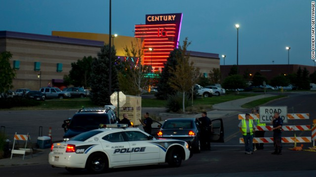 Police block entry into the Aurora Century 16 theater after James Holmes opened fire at a movie theater on July 20, 2012, as the midnight premiere of the latest Batman movie was showing. Holmes killed 12 and wounded dozens more in the Aurora, Colorado, theater. He was arrested and charged with 152 felonies, including murder and weapons offenses. His trial is expected to take place in 2014.