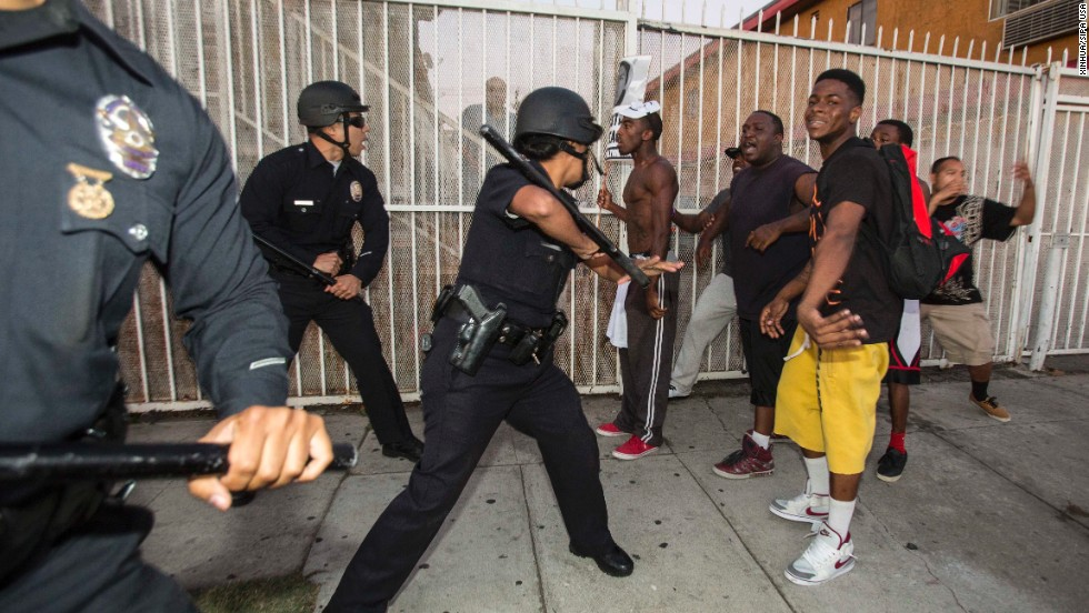 Protesters confront police officers on Monday, July 15, in Los Angeles.