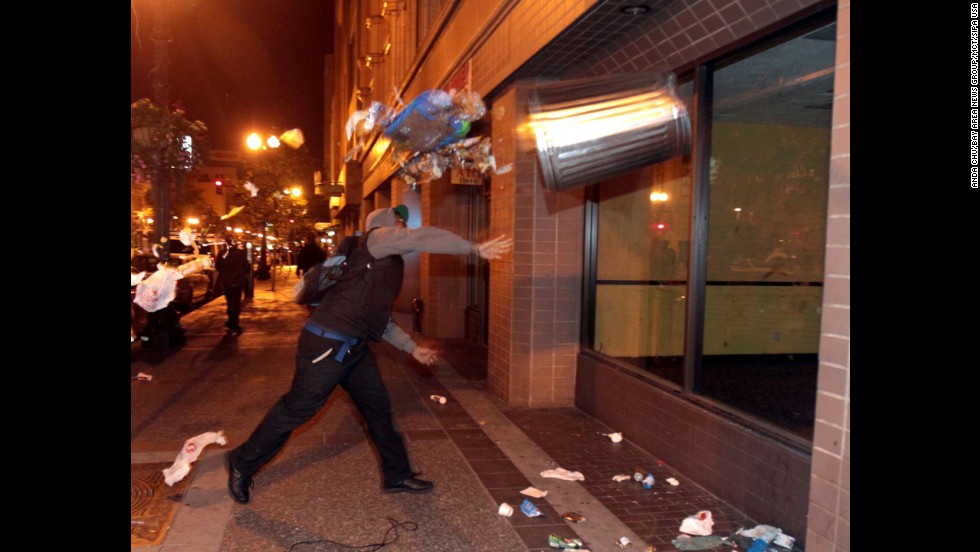 A man throws a trashcan during a protest in Oakland, California, on July 14.