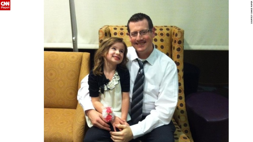 "Chase Roper, a comedy writer and full-time dad of four kids in Puyallup, Washington, poses with his daughter at a father-daughter dance. ""I realized that the way I provide for my family now is by being dad. Once I embraced that, I found my groove."" (<a href=""http://ireport.cnn.com/docs/DOC-1006479"">Read his story.</a>)"
