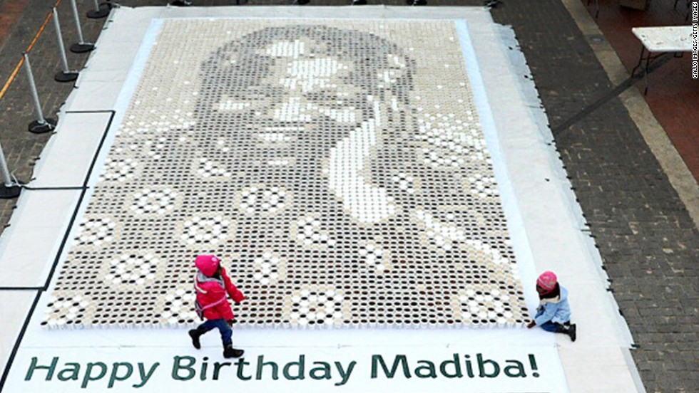 <strong>SOUTH AFRICA:</strong> A giant mosaic of Mandela made from 5,000 cups of coffee is displayed at Constitutional Hill in Johannesburg.