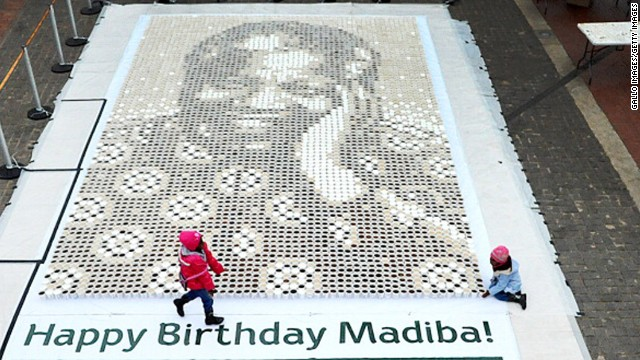 JOHANNESBURG, SOUTH AFRICA - JULY 14. A giant mosaic of Nelson Mandela made from five thousand cups of coffe at constitutional hill  on July 14, 2012 in Johannesburg, South Africa. Jacobs coffee made the giant portrait of Nelson Mandela by taking over 5000 cups of coffee in different shades of Black, White and Brown. The cups were then laid out on dots the same way pixel art is made. (Photo by Gallo Images/Getty Images)