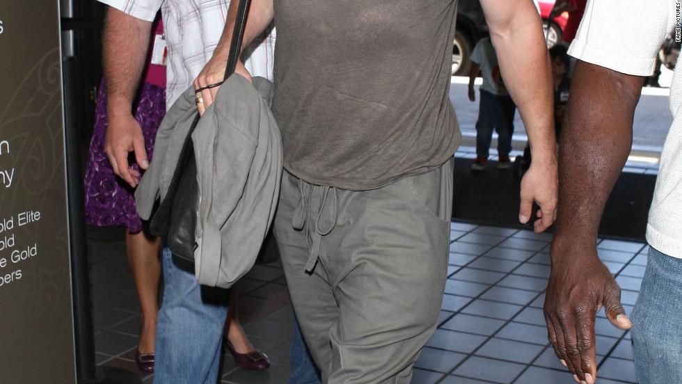 "Brad Pitt looks ready for ""World War Z"" as he gets off a flight on July 16."