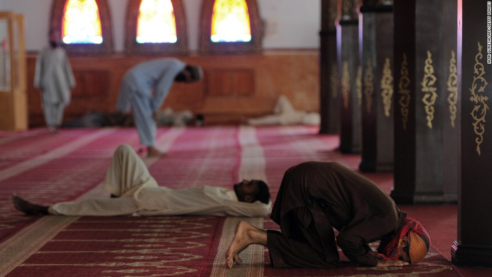Muslims offer noon prayers on July 17 at the Red Mosque in Islamabad, Pakistan.