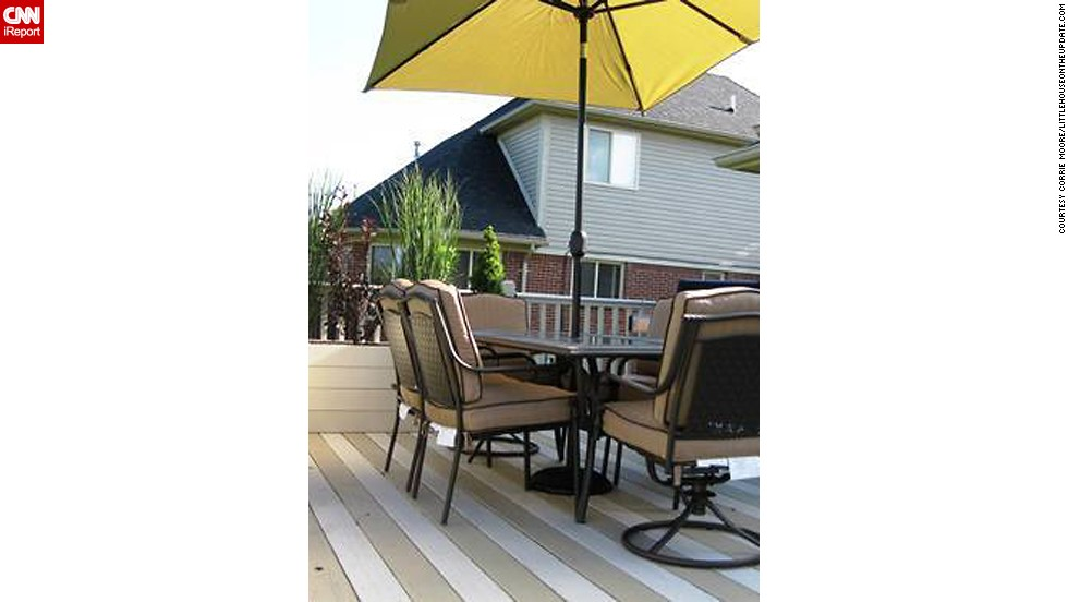 "<a href=""http://ireport.cnn.com/docs/DOC-1005429"">Corrie Moore</a> and her husband painted their deck boards in tan and cream stripes to give the illusion of a larger deck."