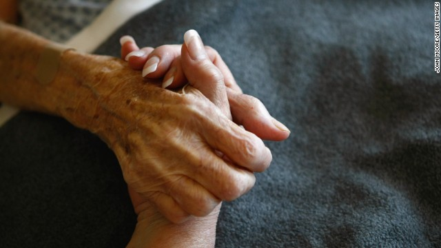 A resident of a Colorado hospice is comforted. In hospice, dying people are kept comfortable without extreme intervention.