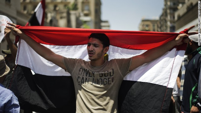 A man holds Egypt's flag as thousands of Morsy supporters demonstrate for his reinstatement in Cairo on Wednesday.