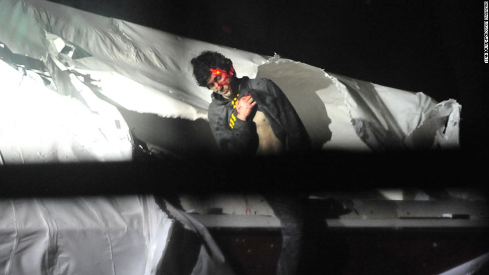 """The <a href=""""http://www.cnn.com/2013/07/17/studentnews/tsarnaev-rolling-stone-cover/"""" target=""""_blank"""">backlash over Rolling Stone's cover photo</a> of Boston Marathon bombing suspect Dzhokhar Tsarnaev led to the release of new photos of his capture. The images, released by Police Sgt. Sean Murphy on July 18, 2013, show Tsarnaev as he emerges from the boat where he hid in Watertown, Massachusetts."""