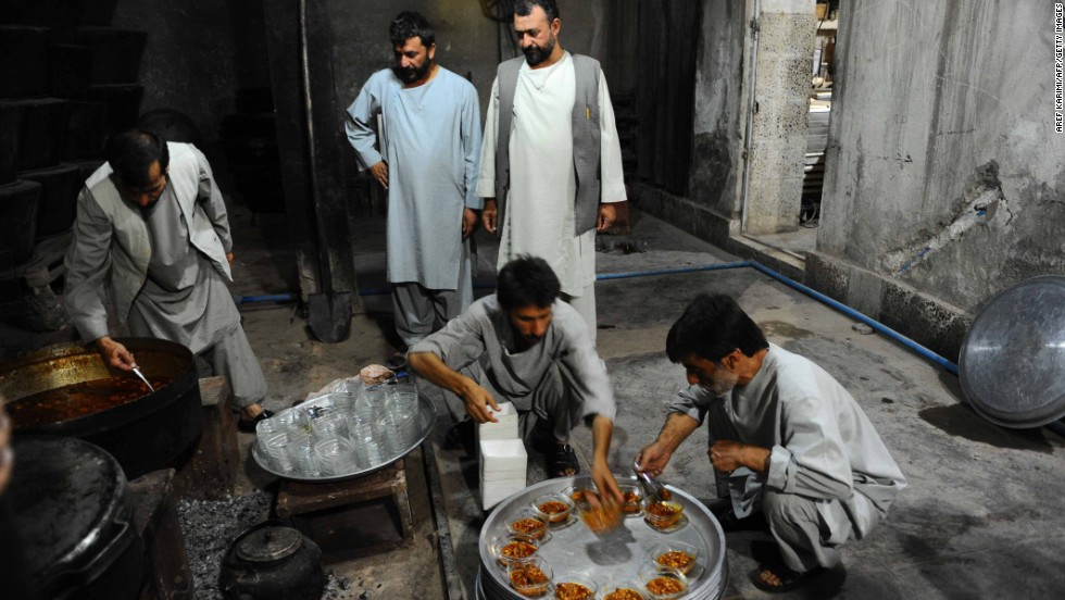 Men prepare food to break their fast during the month of Ramadan in Herat, Afghanistan, Thursday, July 18.