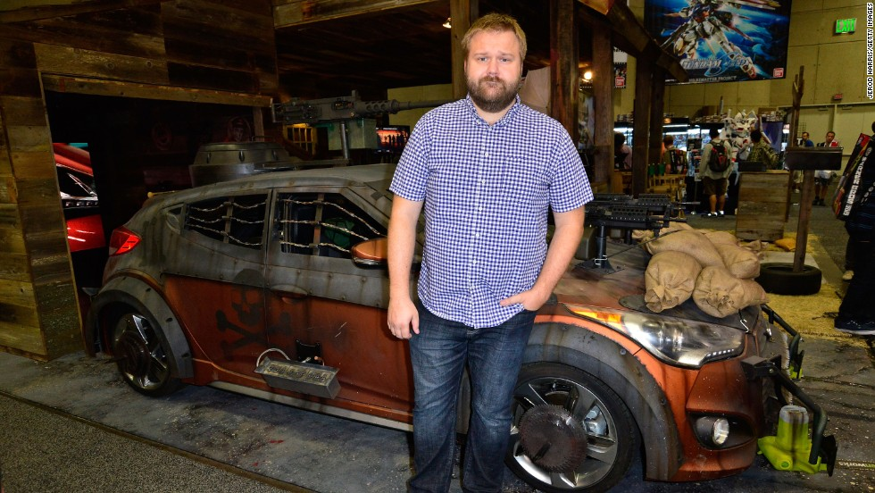 "Robert Kirkman, creator of ""The Walking Dead"" comic, attends the unveiling of ""The Walking Dead"" Zombie Survival Machine at the Future US Booth on Wednesday, July 17."