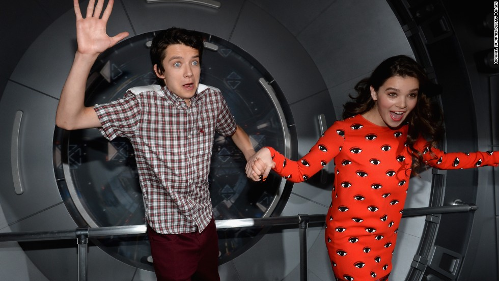 "Actors Asa Butterfield and Hailee Steinfeld attend the ""Ender's Game"" Experience press preview night, sponsored by HGTV, at Martin Luther King Jr. Park on July 17. ""Ender's Game"" is based on the military science fiction novel by Orson Scott Card, and is set to debut on November 1."