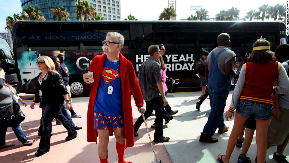 Attendee John Ash wears a Superman themed outfit as he attends the convention on July 19.
