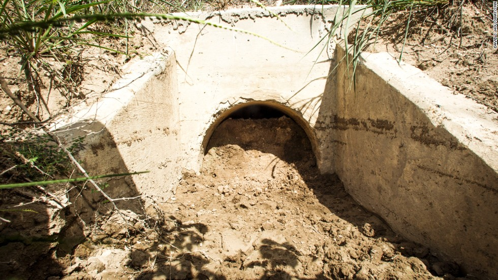 A storm drain in Mission, Texas is filled with soil and rocks in an effort to keep people from hiding in it.