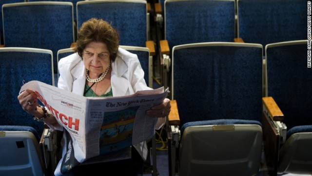 Senior White House Correspondent Helen Thomas reads the newspaper in the White House press room on August 2, 2006 in Washington.