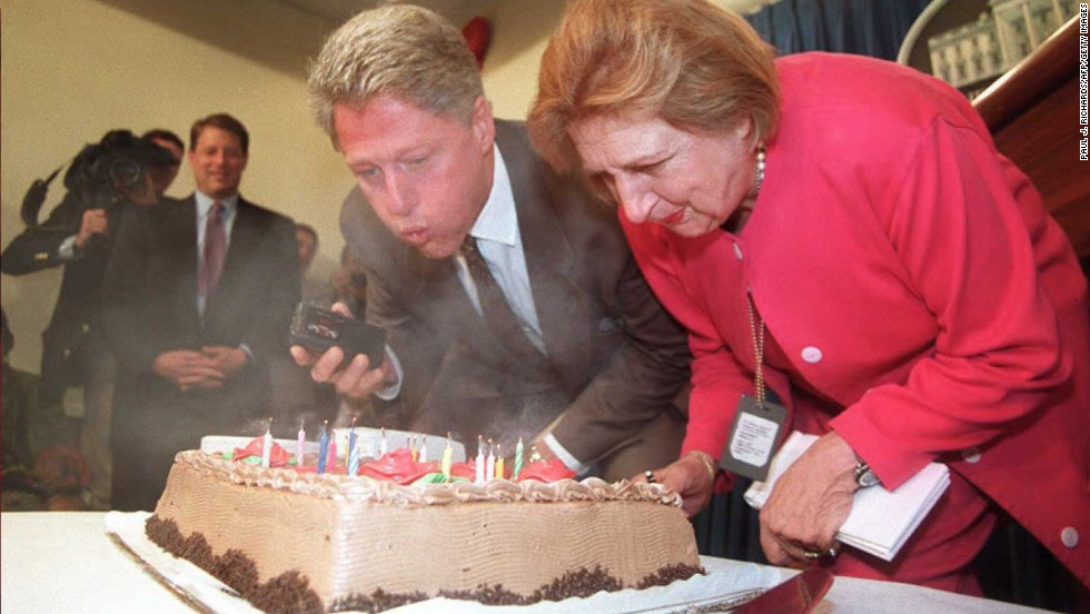 President Bill Clinton and Thomas blow out candles during a surprise 75th birthday party for Thomas in the briefing room at the White House on August 4, 1995.