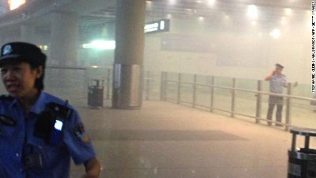 Smoke fills Beijing's airport after a man in a wheelchair ignited a home-made explosive device on July 20.