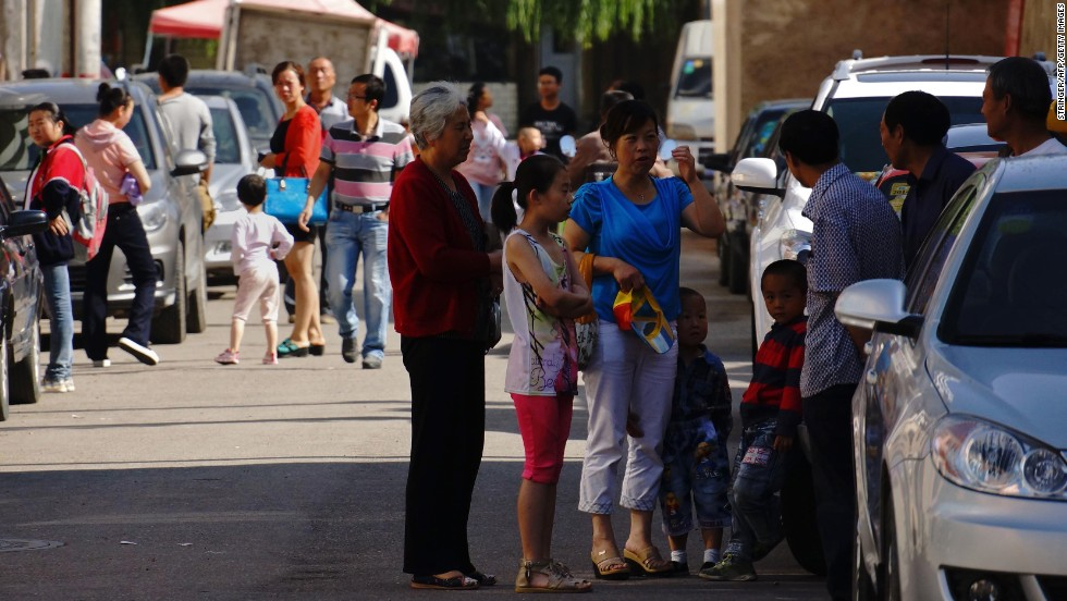 Residents try to take shelter after an earthquake in downtown Dingxi on July 22.