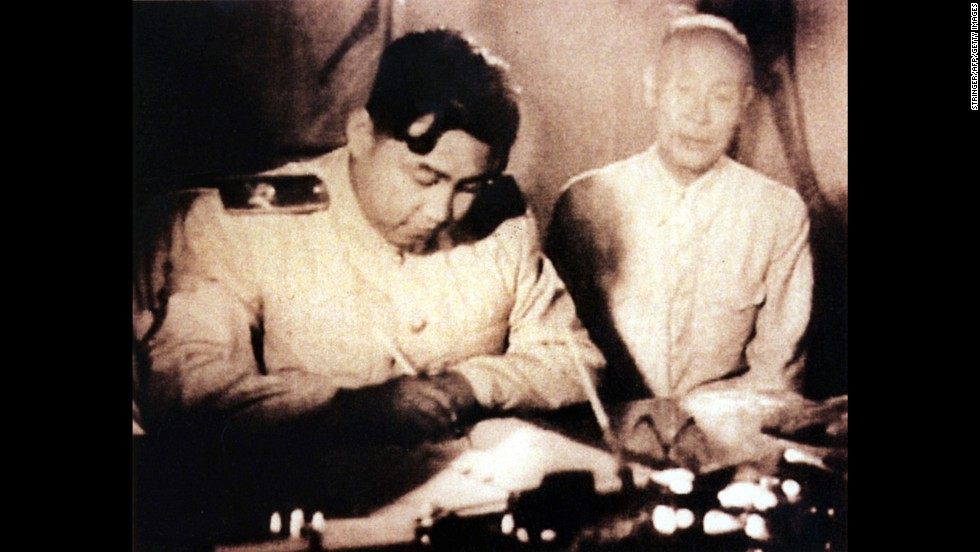 North Korean leader Kim Il-Sung, left, signs a document in Seoul, South Korea, in an undated photo. The armistice ending the war was signed in July 1953, and its terms included the creation of the Demilitarized Zone.