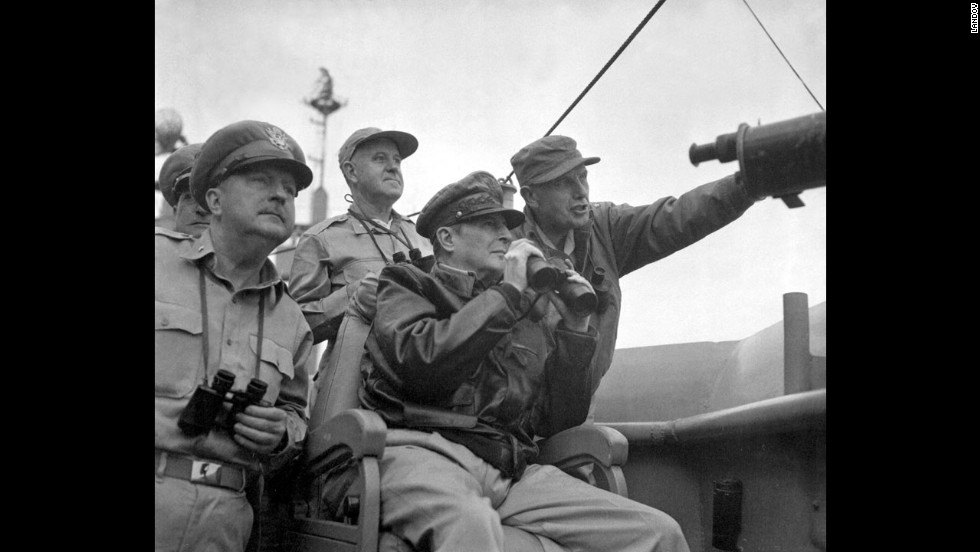 Gen. Douglas MacArthur, center, head of the U.N. Command in the Korean War, and other military personnel observe shelling in Incheon from the USS Mount McKinley in September 1950.