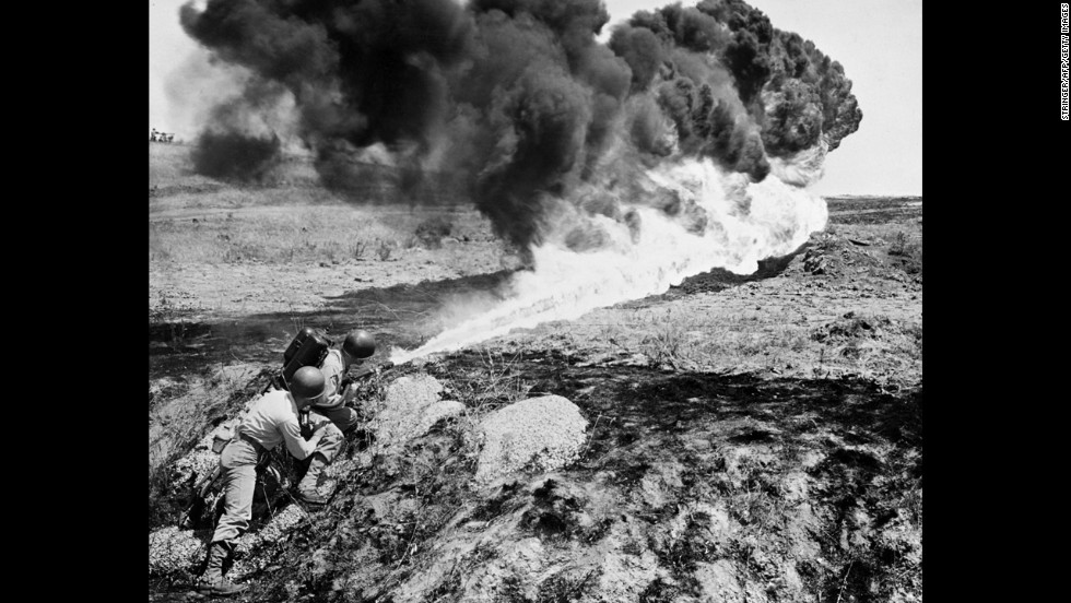 Marines use a flamethrower in April 1951.